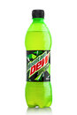 LONDON, UK - JUNE 9, 2017: Bottle of Mountain Dew drink on ice isolated on white. Mountain Dew citrus-flavored soft drink produced Royalty Free Stock Photo