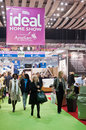 London uk march visitors walk past exhibitor stands ideal home show exhibition Stock Image