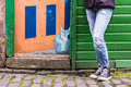 London uk may model wearing converse black sneakers a and torn blue jeans graffiti in the background founded in is an Royalty Free Stock Images