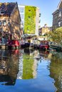 stock image of  LONDON, UK – Oct 21, 2018: Rows of houseboats and narrow boats on the canal banks at Regent`s Canal next to Paddington in Littl