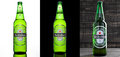 LONDON,UK -OCTOBER 17, 2016: Bottle of Heineken Lager Beer on three different backgrounds. Heineken is the flagship product of Hei Royalty Free Stock Photo