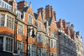 LONDON, UK: Red brick Victorian houses facades in Mount Street borough of Westminster Royalty Free Stock Photo