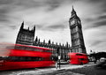 London, the UK. Red buses and Big Ben, the Palace of Westminster. Black and white Royalty Free Stock Photo