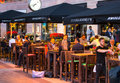 LONDON, UK - 7 SEPTEMBER, 2015: Canary Wharf night life. People sitting in local restaurant after long hours working day Royalty Free Stock Photo