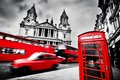 London, the UK. St Paul's Cathedral, red bus, taxi cab and red telephone booth. Royalty Free Stock Photo