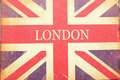 London union jack a and sign on old woven fabric with stains and scratches Royalty Free Stock Photography