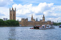 London united kingdom july barges are sailing by the parliament house and big ben on the thames river in Royalty Free Stock Photos