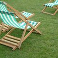 Sun chairs in the park Royalty Free Stock Photo