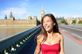 London woman happy in summer candid smiling girl by big ben walking on westminster bridge england uk travelling tourism Stock Photo