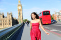 London woman happy walking by big ben england tourist on europe travel sightseeing running in joy red double decker bus Stock Image