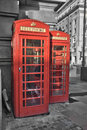 Londoner red phone booths in a street Royalty Free Stock Photo