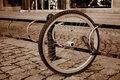 A lone bicycle wheel in a street Royalty Free Stock Photo