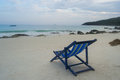 A lone and empty sunbed on the beach in evening in tropical island in thailand Royalty Free Stock Photography