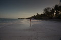 Lone figure on beach in Michamwi-Pingwe Zanzibar, Royalty Free Stock Photo