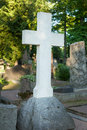 Lone marble cross at a cemetery Stock Image