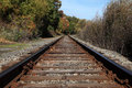 Lone railroad tracks curve Royalty Free Stock Photos
