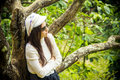 Loneliness women under the cherry tree woman Royalty Free Stock Photos
