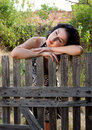 Lonely against a fence pretty woman leaning wooden Stock Photos