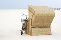 Lonely Beach chair with bike at the beach of St.Peter Ording Royalty Free Stock Photo