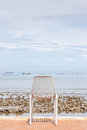 Lonely beach chair and sea beach background. Concept for rest, r Royalty Free Stock Photo