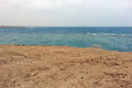 Lonely bench on beach, Egypt, Marsa Alam, Red Sea Royalty Free Stock Photo