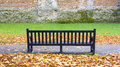 Lonely bench at colchester castle park essex uk Royalty Free Stock Images