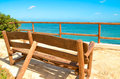 Lonely bench on a viewing platform with views of the sea back view Royalty Free Stock Photos