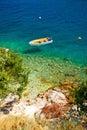 Lonely boat on idyllic beach