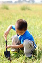 Lonely boy in the field Royalty Free Stock Photo