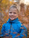 stock image of  Lonely boy with a smile in autumn Park