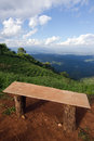 Lonely chair with grass, mountain and cloudy sky view of Chiangm Royalty Free Stock Photo