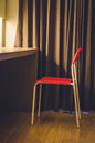 Lonely chair in the hotel room: vintage tone Royalty Free Stock Photo
