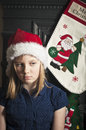 Lonely christmas child portrait of a young sad and at time Royalty Free Stock Photo