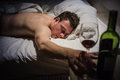 Lonely drunk man sleeping after a bottle of wine Royalty Free Stock Photo