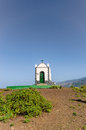Lonely and forsaken stands this little chapel on the top of the volcanic cone montaña de los frailes with a fantastic view Royalty Free Stock Photos