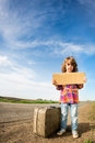 Lonely girl with suitcase Royalty Free Stock Photo