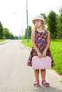 Girl with suitcase standing on road Royalty Free Stock Photo