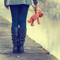 Lonely girl with teddy bear near river Royalty Free Stock Photo