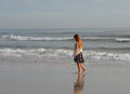 Lonely girl walking on beach young daytona fl Royalty Free Stock Image