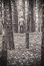 A lonely guy in a pine forest in the autumn time. Monochrome Royalty Free Stock Photo
