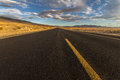 Lonely highway in desert of California, USA Royalty Free Stock Photo