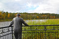 The lonely man costs on the bank of the Quiet lake. Svetlogorsk, Royalty Free Stock Photo