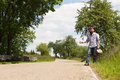 Lonely man on a road holding thumb up Royalty Free Stock Photography