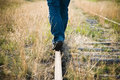 Lonely man walking on a railroad track Royalty Free Stock Photos