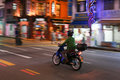 Lonely motorcyclist rides through the city. Royalty Free Stock Photo