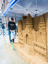 Lonely planet artist works on intricate sand sculpture in city o london england august of london Stock Images