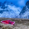 Lonely Red Fishing Boat At Skagsanden Beach in Norway Royalty Free Stock Photo