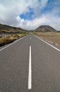 Lonely road in the deseret on a cloudy sky Royalty Free Stock Photography