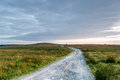 Lonely road a winding track through moorland on bodmin moor in cornwall Royalty Free Stock Image