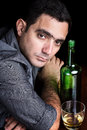 Lonely and sad hispanic man drinking alone Royalty Free Stock Photo
